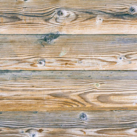 Background of old wooden boards for design. The texture of dry wood planks