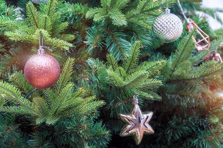 Christmas balls on the Christmas tree branch. Magic lights. Selective focus Zdjęcie Seryjne