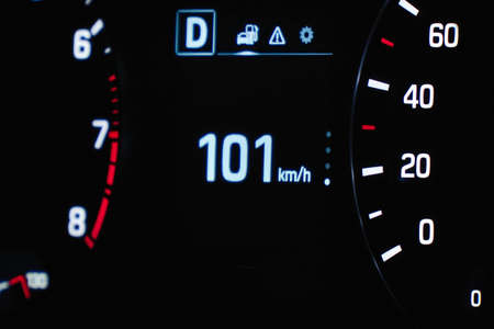 Speedometer in the car on the dashboard. The cars speedometer shows 101 mph