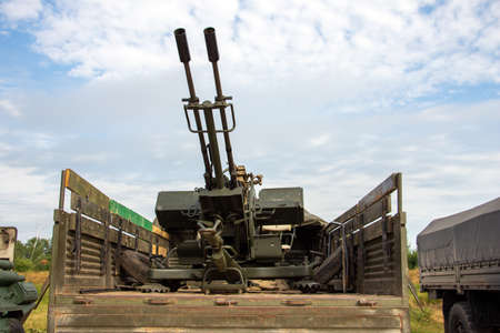 Double-barreled anti-aircraft gun in the back of the car