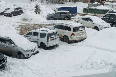 Cars covered with snow in the Parking lot