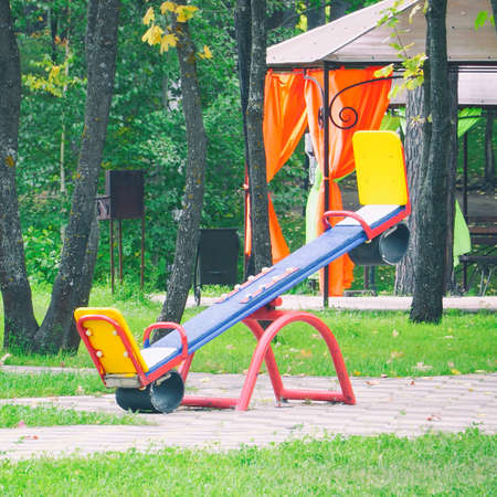 Empty, without children, childrens swings in Park Reklamní fotografie