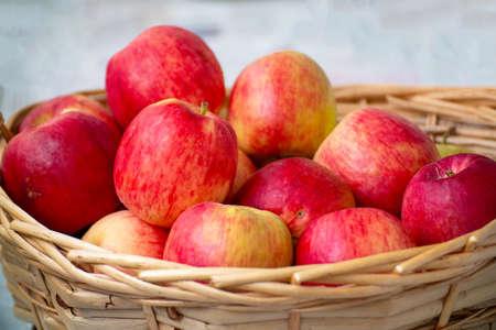 Red ripe apples in a wicker basket Stock fotó