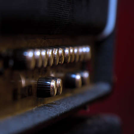 Knobs for volume, tone and various settings on the guitar amp