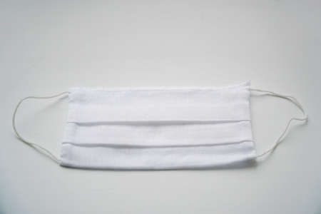 White protective medical face mask on white