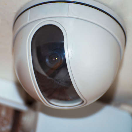 Security camera on the light ceiling in office Stock fotó