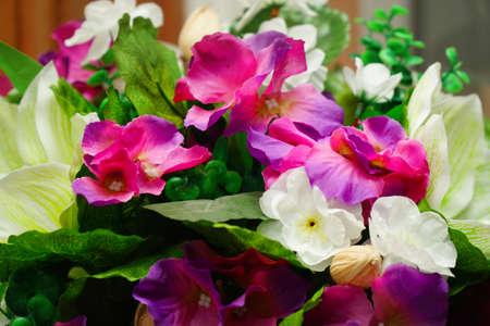 Bouquet of beautiful artificial flowers Фото со стока