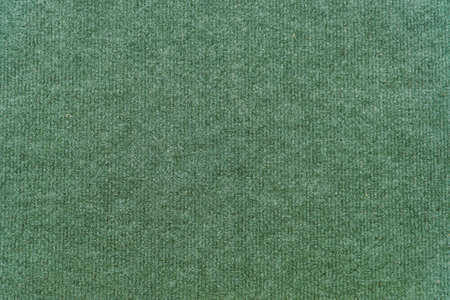 Green synthetic wool carpet for background Фото со стока