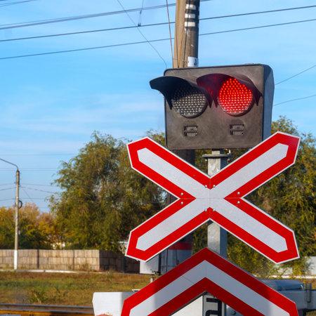 Traffic light or semaphore flashing red at railway crossing