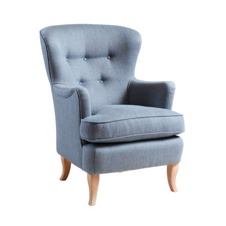 Upholstered Blue Wing Chair with Wooden Feet Isolated on White Background. Side View of Modern Wingback Accent Club Armchair with Upholstered Wings and Armrests. Interior Furniture