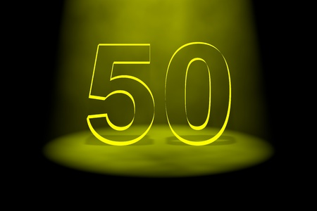 Number 50 illuminated with yellow light on black background photo