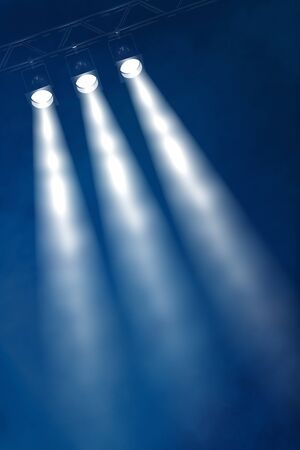 Stage lighting: Abstract dark background with three stage spotlights Stock Photo