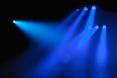 stage lights: Abstract dark background with bright blue stage spotlights Stock Photo