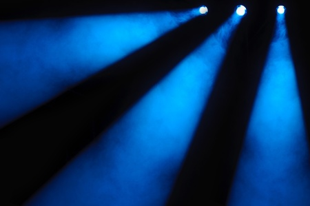 lighting effects: Abstract dark background with bright blue stage spotlights Stock Photo