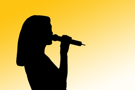 amplify: Silhouette in profile of a female vocalist holding a microphone to her lips against a yellow background Stock Photo