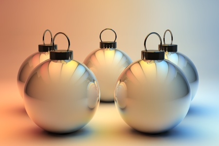 many christmas baubles: Five shiny silver baubles - Christmas ornaments background Stock Photo