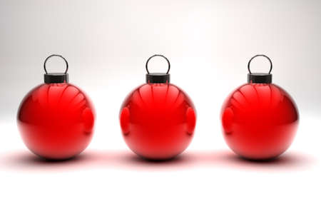 Three shiny red Christmas baubles on white background photo