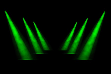 three angled: Six angled spotlights staggered and diminishing in two symmetrical rows of three with a foggy atmosphere Stock Photo