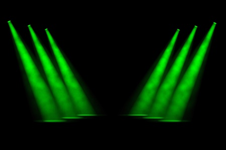 limelight: Six staggered green spotlights in two receding rows of three shining down onto an empty stage against a smoky background Stock Photo
