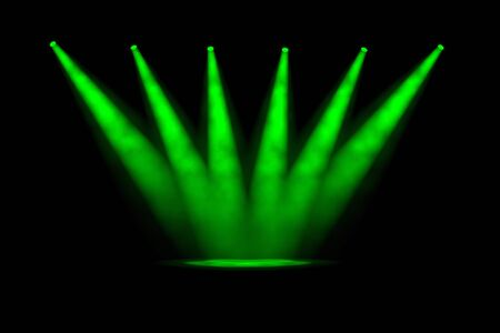 converging: Six green spotlight beams converging to a single point on the stage with smoky fog and a dark background Stock Photo