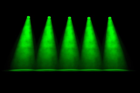 Five separate foggy green spotlights side by side shining downwards onto an empty stage on a dark background Stock Photo - 13499882
