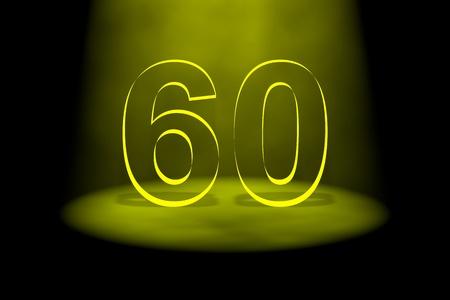 Number 60 illuminated with yellow light on black background photo