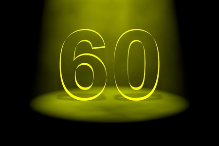 sixtieth: Number 60 illuminated with yellow light on black background Stock Photo