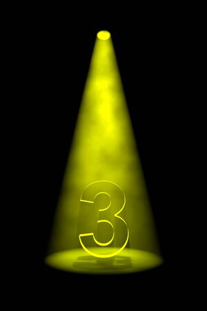 third birthday: Number 3 illuminated with yellow spotlight on black background