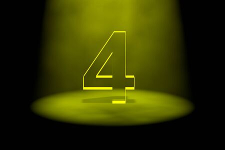 spotlit: Number 4 illuminated with yellow light on black background