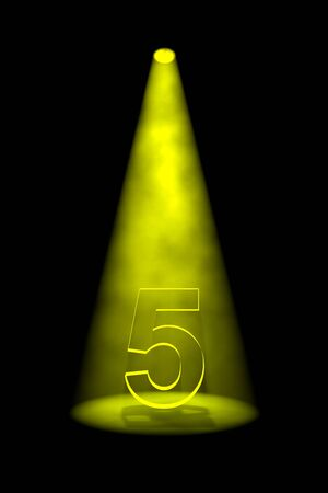limelight: Number 5 illuminated with yellow spotlight on black background