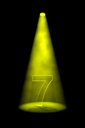 seventh: Number 7 illuminated with yellow spotlight on black background