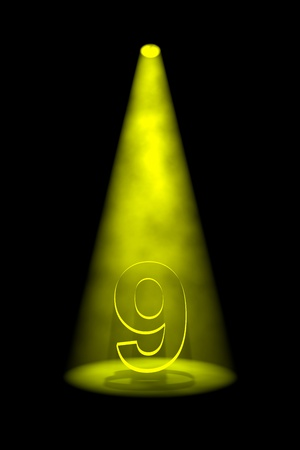 9th: Number 9 illuminated with yellow spotlight on black background Stock Photo