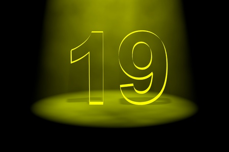 spotlit: Number 19 illuminated with yellow light on black background