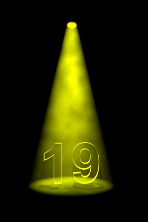 19: Number 19 illuminated with yellow spotlight on black background