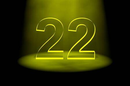 Number 22 illuminated with yellow light on black background Stock Photo - 13588616