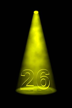 26th: Number 26 illuminated with yellow spotlight on black background Stock Photo