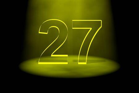 Number 27 illuminated with yellow light on black background photo