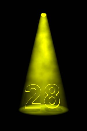 Number 28 illuminated with yellow spotlight on black background Stock Photo - 13588673
