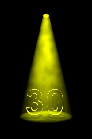 spotlit: Number 30 illuminated with yellow spotlight on black background Stock Photo