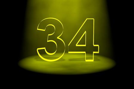 34: Number 34 illuminated with yellow light on black background