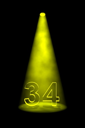 34: Number 34 illuminated with yellow spotlight on black background