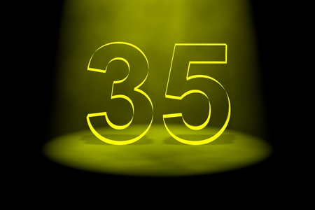 spotlit: Number 35 illuminated with yellow light on black background