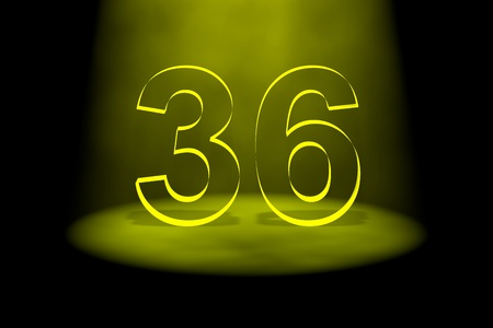 number 36: Number 36 illuminated with yellow light on black background