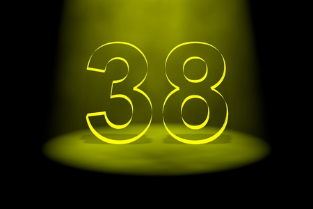 38: Number 38 illuminated with yellow light on black background