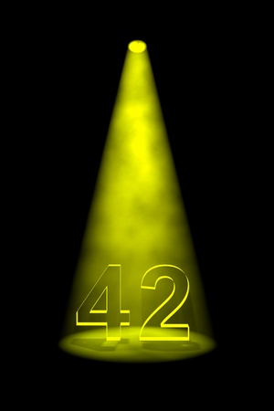 Number 42 illuminated with yellow spotlight on black background Stock Photo - 13588702