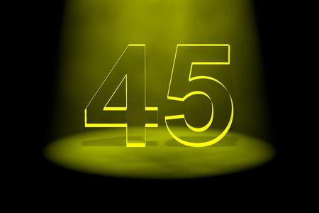 Number 45 illuminated with yellow light on black background photo