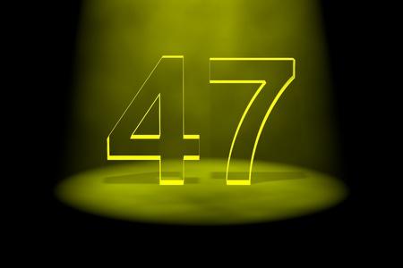 Number 47 illuminated with yellow light on black background photo