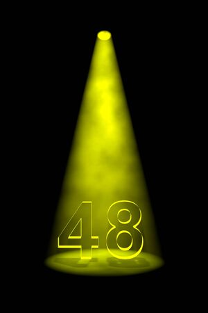 48: Number 48 illuminated with yellow spotlight on black background Stock Photo