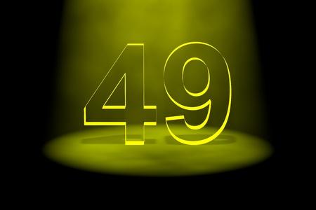 Number 49 illuminated with yellow light on black background photo