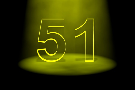 Number 51 illuminated with yellow light on black background Stock Photo - 13588522